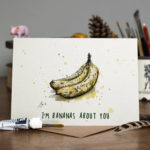 Valentines Day Card of a bunch of bananas on a wooden table top