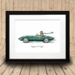 Print of a Jaguar wearing a flat cap and scarf driving a green jaguar e-type in a black frame on a curved wooden background