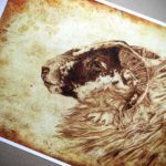 Print of a sheep's head on an aged textured background