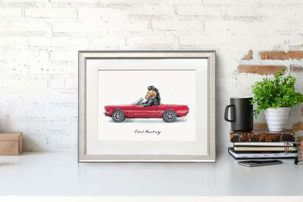 Print of a Mustang horse wearing a leather jacket driving a red ford mustang car in a white frame sitting on a white desk