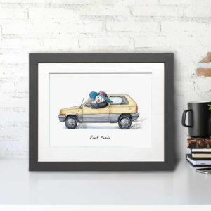 Print of an old yellow fiat panda car being driven by a panda wearing a sunhat in a grey frame sitting on a white desk