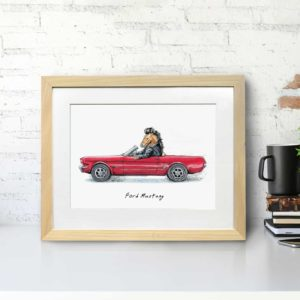 Print of a Mustang horse wearing a leather jacket driving a red ford mustang car in a light wood frame sitting on a desk