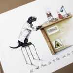 Print of a black labrador wearing a white Lab coat sitting at a desk in a science lab cooking sausages over a Bunsen burner