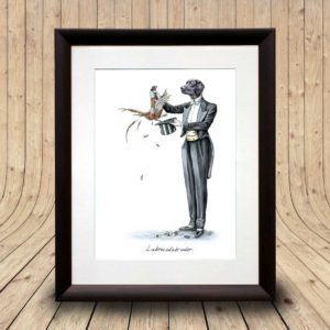 Print of a Black Labrador in a magician's outfit pulling a pheasant out a hat in a dark wood frame on a wooden background
