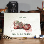 Valentines Day card of red tomatoes on a wooden table