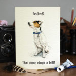 Greetings card of a Parson Jack Russell Terrier with a blue collar sitting on a wooden table