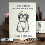Greetings card of a black and white drawing of a Shih Tzu which illustrates a joke on a wooden table