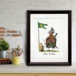 Print of a chicken dressed in a nomadic tribal outfit as Attila The 'Hen' in a dark wood frame leaning against a brick wall
