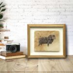 Original pen and ink drawing of a float mounted sheep in a wooden frame sitting on a desk against a brick wall